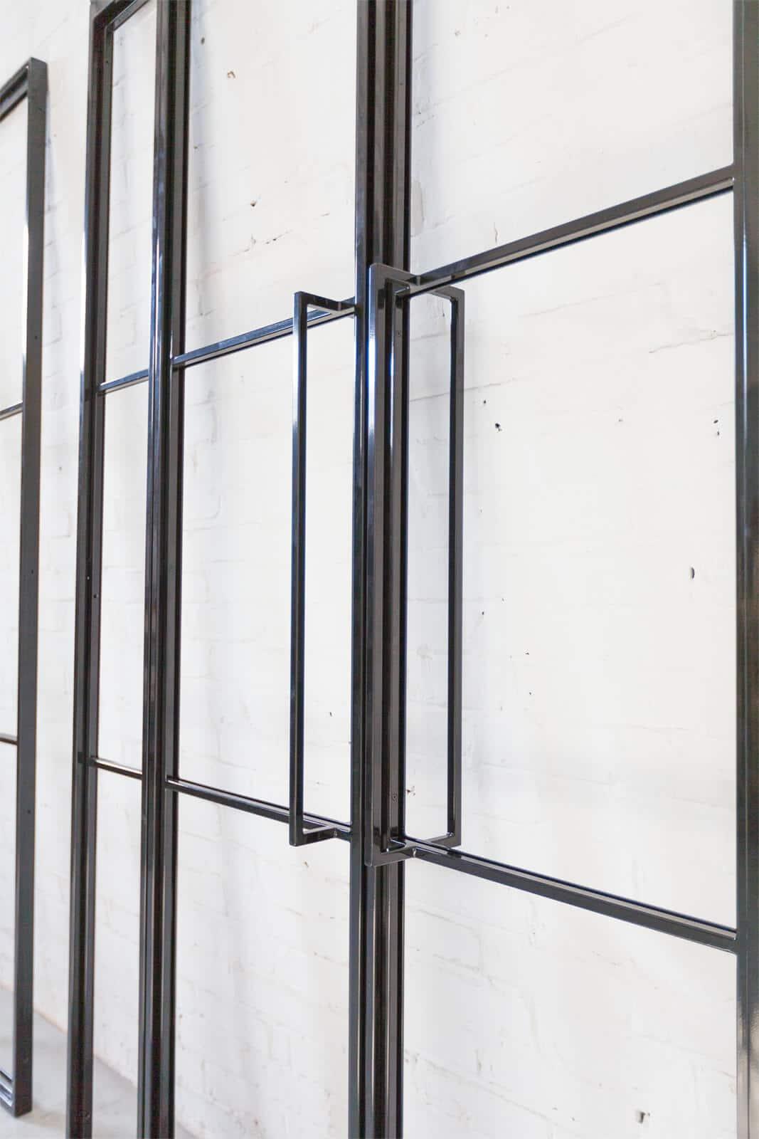 N51E12 Stahl Loft Tür, Doppeltür, Pivottür, Schwingtür, Pivot, Raumtrenner, Trennwand, Glastrennwand, Oberlicht, Designtür, Lofttür, Industrial Door, Stahlrahmen, Glanz, RAL 9005, Tiefschwarz, Schwarz, Glastür